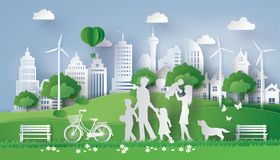 Paper cut of eco. Concept of eco with happy family walking on the field  .paper art style Stock Photos