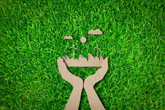 Paper cut of  eco friendly city. On grass Stock Images
