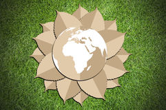 Paper cut of eco on green grass Royalty Free Stock Image