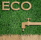 Paper cut of eco on green grass. Royalty Free Stock Image