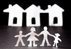 Paper cut family with background housing Stock Photo