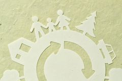 Paper cut of family with home, trees, car - Ecology concept stock illustration
