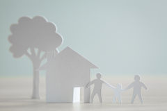 Paper cut of family with house Stock Photography