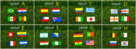 Paper cut of flags on grass for Soccer championship 2014 Stock Photo