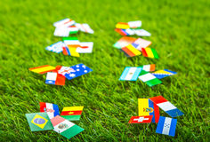 Paper cut of flags on grass for Soccer championship 2014 Stock Image
