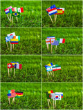 Paper cut of flags on grass for Soccer championship 2014 Stock Photos