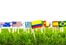 Paper cut of flags on grass for Soccer championship 2014 Royalty Free Stock Photography