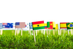Paper cut of flags on grass for Soccer championship 2014 Stock Photography