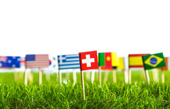 Paper cut of flags on grass for Soccer championship 2014 Royalty Free Stock Photos