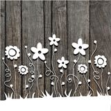 Paper  cut flowers on wooden background Stock Photo