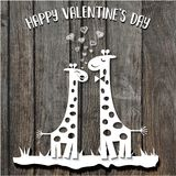 Paper cut giraffes in love, Valentine`s Day card on wooden backg Royalty Free Stock Photo