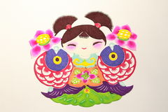 Paper-cut of a girl and double fish Royalty Free Stock Images