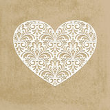 Paper cut heart. Greeting card with paper cut lacy heart Royalty Free Stock Photo