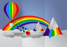 Paper cut heart shape with rainbow and balloons rainbow colors for LGBT or GLBT pride, or lesbian, gay, bisexual, transgender, on. Blue background Stock Images
