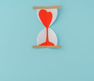 Paper cut of Hearts in Sand Clock . Stock Photography