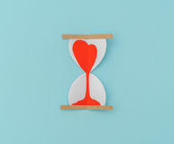 Paper cut of Hearts in Sand Clock . Stock Photos