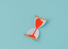 Paper cut of Hearts in Sand Clock . Royalty Free Stock Image
