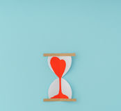 Paper cut of Hearts in Sand Clock . Royalty Free Stock Photography