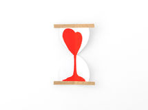 Paper cut of Hearts in Sand Clock . Royalty Free Stock Photo