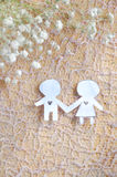 Paper Cut in Lover Shape Holding Hand. On lace background Royalty Free Stock Photography