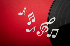 Paper cut of music note on Black vinyl record lp album disc with copy space for text. Or design royalty free stock image