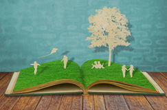 Paper Cut Of Children Play On Old Book Stock Images