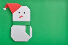 Snow man. Paper cut out of Christmas snow man under green background stock illustration