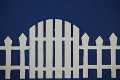 Paper cut out of gate of white picket fence Stock Photos