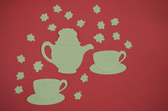 Paper cut out of teapot and cups on red background Stock Photography