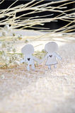 Paper Cut in Shape Couple with Flower and Stick on Background Stock Images