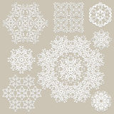 Paper Cut Snowflakes. Highly detailed paper cut white snowflakes Stock Images
