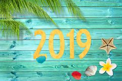 2019, tropical vacation background with palm tree and seashells royalty free stock photo