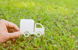Paper cut of truck on green grass background Royalty Free Stock Images