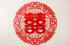Paper-cut and two abstract people and the wedding ring. Double happiness refers to when Chinese married, the use of words. There are 2 abstract people and a pair Stock Photography