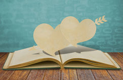 Paper cut of two heart and arrow Royalty Free Stock Image