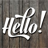 Paper cut word HELLO on wooden background Stock Image