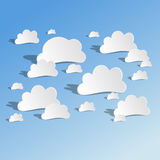 Paper Cutout Clouds on Blue Sky with Long Shadows Stock Image