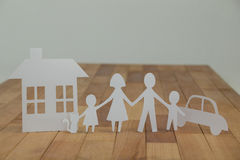 Paper cutout family with house and car Royalty Free Stock Photos