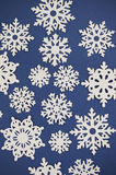 Paper Cutout Snowflake Background Stock Photography