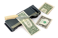 Paper cutter and dollars Royalty Free Stock Photography