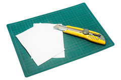 Paper and cutter Royalty Free Stock Photos