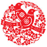 Paper-cutting of double Magpie. Standing on the peach blossom Royalty Free Stock Images