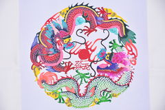 Paper cutting two dragon game Stock Image
