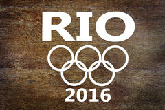 Paper cuttings about Olympic Games in Rio de Janeiro on wooden background Royalty Free Stock Images