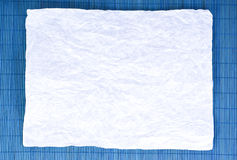 Paper on a dark blue background. White paper on a dark blue background Royalty Free Stock Image