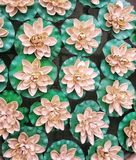 Paper decor flowers. This is a photo of a bunch of decorative paper flowers placed outside a shopping mall in Kolkata Stock Photo