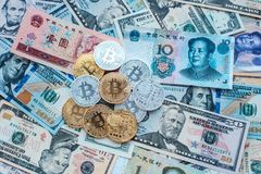 Paper denominations US dollars, Chinese yuan, metal coins, bitcoin gold and silver, money background. Royalty Free Stock Photos