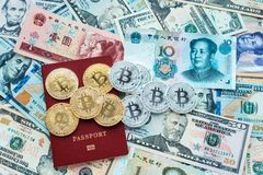 Paper denominations US dollars, Chinese yuan, red passport, metal coins bitcoin gold and silver. Paper denominations of US dollars, Chinese yuan, red passport Stock Image