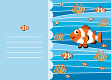 Paper design with clownfish swimming Stock Photos