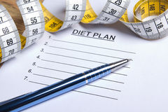 Paper with diet plan, pen and measure tape Stock Photos
